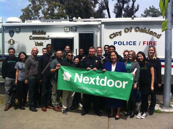 Nextdoor employees pose with Police Chief Whent and Mayor Quan.