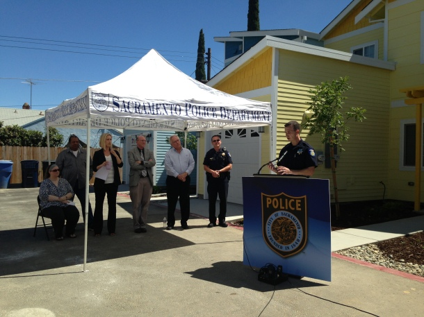 olice Chief Samuel Somers, Jr. speaks in front of the Department's most recent Habitat for Humanity construction.