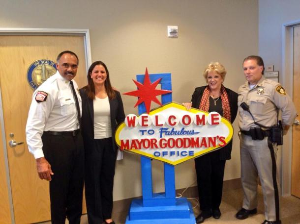 Fire Chief William McDonald, Nextdoor Co-Founder Sarah Leary, Mayor Carolyn G. Goodman, and Police Captain Shawn Andersen celebrate the announcement.