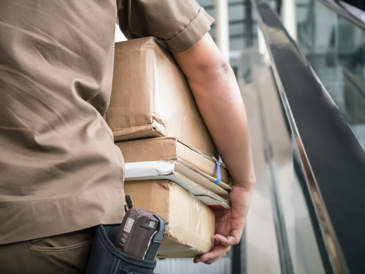 Postman carrying parcels